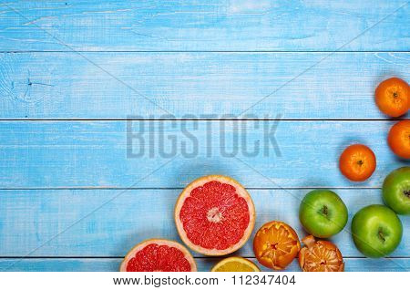 Fruit Background - Grapefruit, Apples, Oranges And Tangerines