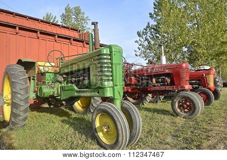 John Deere and Farmall tractors