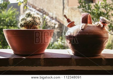 Earthenware Pitcher And Flower Pot Of Clay Against The Light.