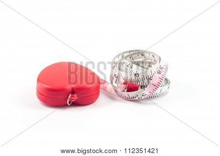 Measuring Tape In Heart Shape On White Background