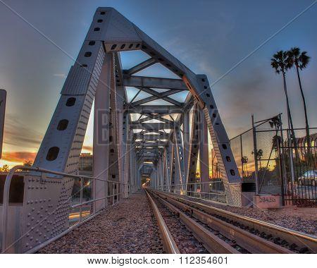 Train tracks across the bridge