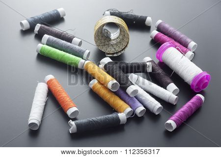Spools Of Sewing Thread Isolated On Gray