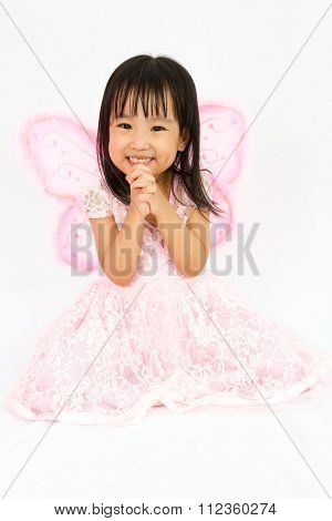 Chinese Little Girl Wearing Butterfly Custome With Praying Gesture