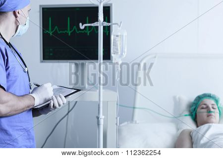 Nurse Monitoring Patient's Vital Functions