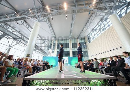 MOSCOW - JUL 09, 2015: Two women shows a uniforms flight attendant at a special screening of uniforms airlines DME RUNVAY in Domodedovo