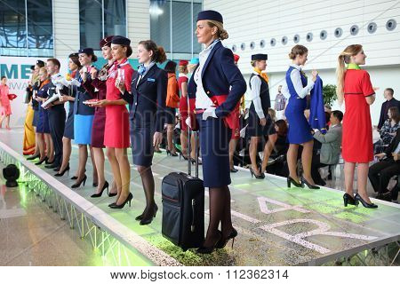 MOSCOW - JUL 09, 2015: Beautiful women shows a uniforms flight attendant at a special screening of uniforms airlines DME RUNVAY in Domodedovo