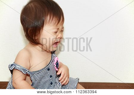 Crying Japanese baby girl (0 year old)