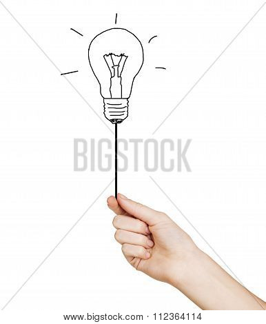 Hand Holding Drawn Light Bulb