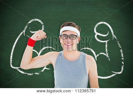 Geeky hipster posing in sportswear against green chalkboard