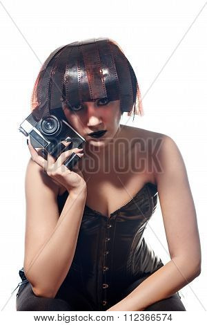 Woman with film camera rolls