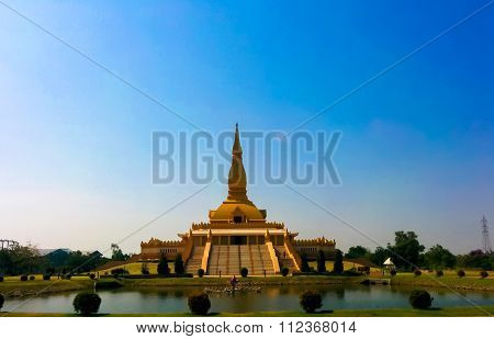Gold Pagoda With Blue Sky Background