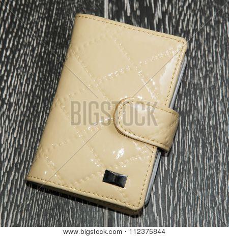 Yellow Card Holder On Dark Background
