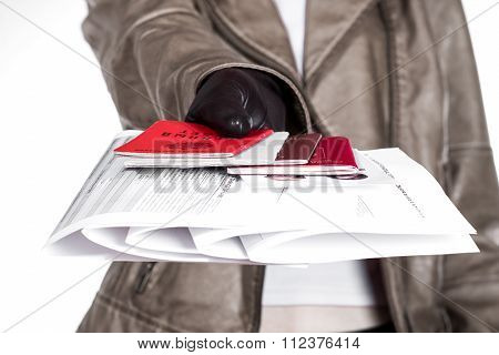 Woman fills the document forms at the table