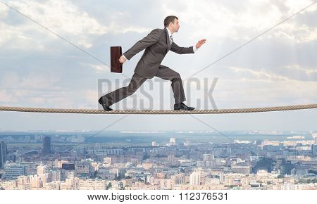 Businessman running on rope