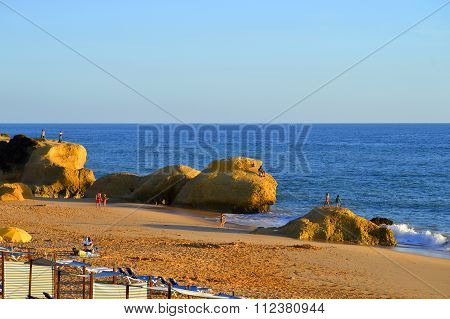 Praia Da Gale Beach tourists enjoying the evening sun