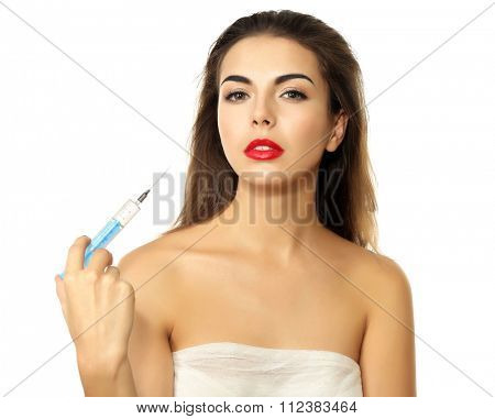 Young beautiful woman with a gauze bandage on her chest, holding syringe, isolated on white