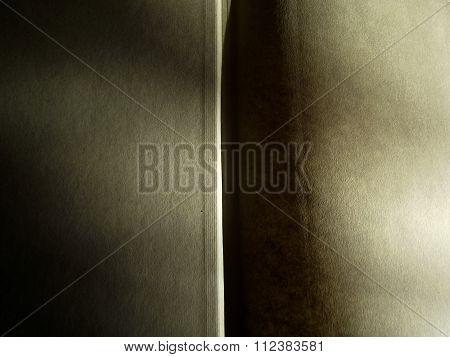 Open Hardback Book with Heavy Sunlight Shadow