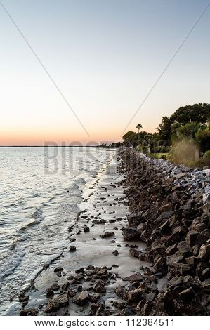 Stone Seawall At Sunset