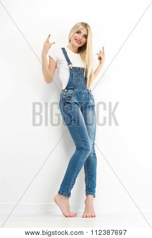 Portrait Of Stylish Blond Young Woman,  Wearing Jeans Overalls