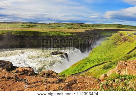 Enormous waterfall Gyullfoss. Water abyss. Summer in Iceland
