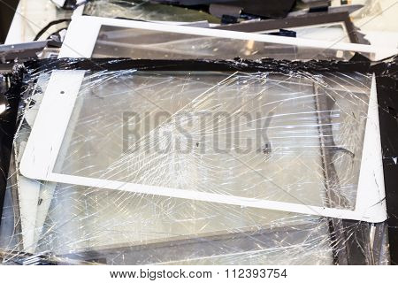 Stack Of Damaged And Shattered Tablet Pad Computer Screen