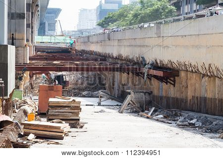 Construction Of Tunnel Underpass Beneath Train Line Within City Setting