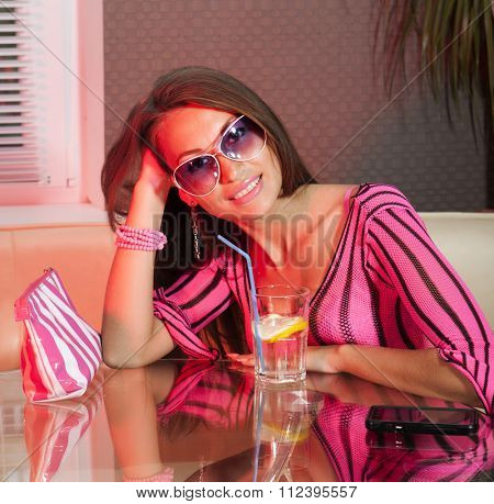 pretty woman drinking cocktail in nightclub