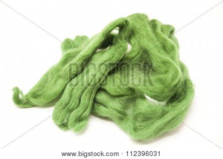 Olive green piece of Australian sheep wool Merino breed close-up on a white background.