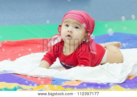 Asian Baby Looking At Bubble In The Air