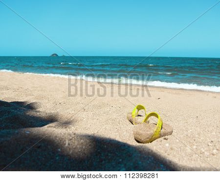 Vacation with sandals on the beach