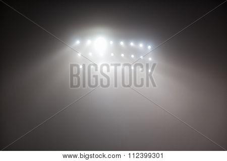 Bright White And Yellow Stadium Lights With Fog