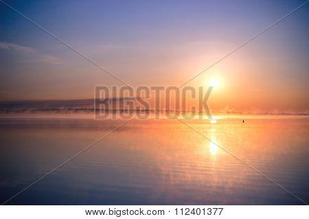 Idyllic landscape with lake towards the rising sun