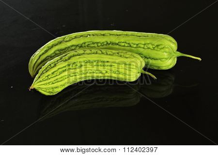 bitter cucumber on black counter