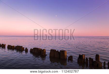 Pillars In Water At Sunset