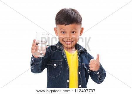 Happy boy with bottle of water and showing thump up isolated on white background
