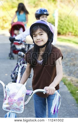 Children with their bikes outdoors