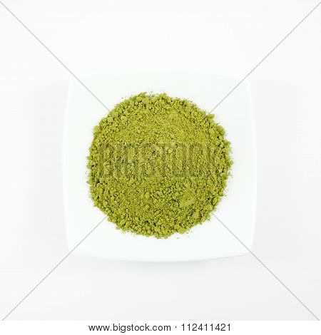 Japanese matcha green tea powder on the mini white dish