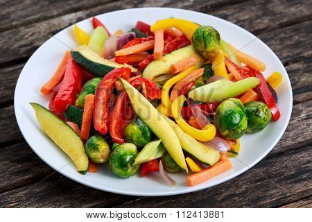 Cooked Roasted Vegetables, on old wooden table.