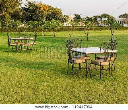 Two tables with chairs outdoors in the morning