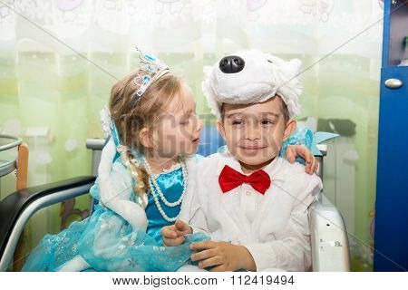 Two Children Dressed In Carnival Suits In New Year's Children's Holiday