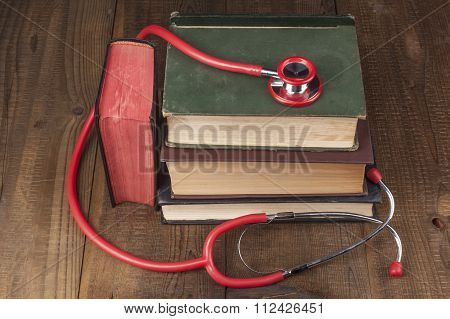 Books And Red Stethoscope
