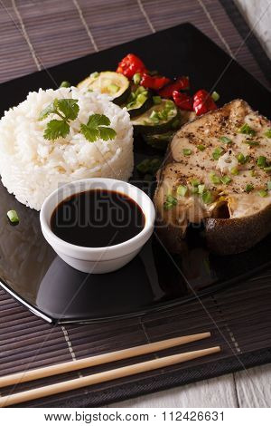 Asian Cuisine: Steak White Fish, Rice And Sauce Close-up. Vertical