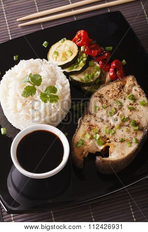 Baked Steak Of Fish, Rice And Soy Sauce Close-up. Vertical Top View