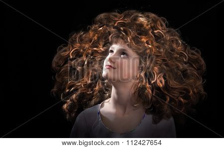 The girl's face and a lot of curly red hair. Great volume, bright color, luxurious curls