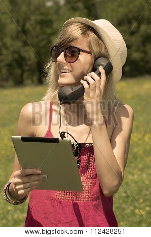 Young female having an internet call by using retro telephone headset
