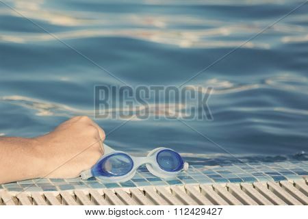 Holding goggles