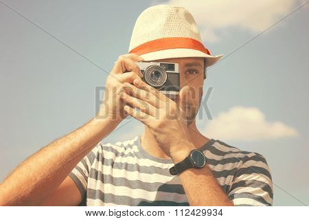 Man with the old camera - retro stile