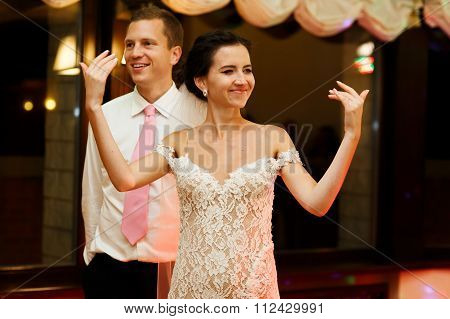 Happy brunette bride in vintage white dress and handsome groom d
