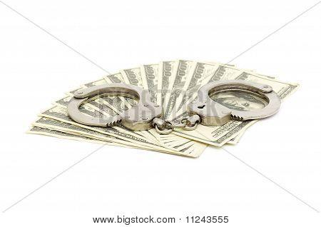 Handcuffs on money background,