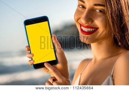 Woman showing phone with white screen